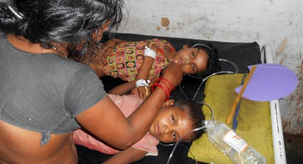 Children receive treatment at a hospital after falling ill soon after eating a free meal at a primary school in Chhapra district, eastern India. Picture: AP