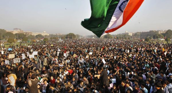 Protesters gather under an Indian flag near the Presidential Palace during a protest in New Delhi this weekend. Picture: AP