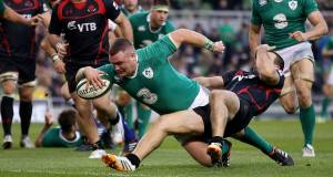 Dave Kilcoyne scores Ireland's first try despite David Kacharava of Georgia. Picture: INPHO