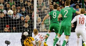 LATE REPRIEVE: Shane Long pokes home Ireland's equaliser in injury time at Aviva Stadium last night.