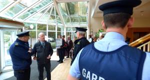 Protesters and Gardai at Silversprings, Cork, for the meeting of Councillors and Irish Water officials. Picture: Denis Scannell/Irish Examiner