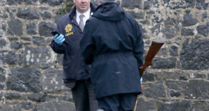 Gardaí removing the rifle in Clarecastle.