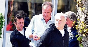 Jeremy Clarkson, Richard Hammond, James May and former Top Gear executive producer Andy Wilman leave Jeremy's flat after holding a business meeting about the future of the show.