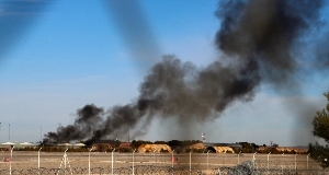 Smoke rises from a military base after a plane crash in Albacete, Spain, Monday, Jan. 26, 2015.