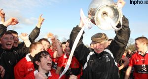 UCC's Jim Roche lifts the Fitzgibbon Cup. Picture: INPHO/Lorraine O'Sullivan