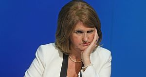 Arrested protesters who trapped Joan Burton in her car have received support from the Irish abroad.