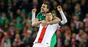 John O'Shea gets to grips with Robert Lewandowski last night. Picture: Niall Carson