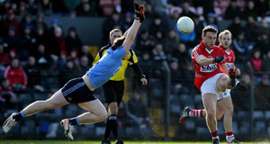 BLUE THUNDER: John Small dives to block John O'Rourke's shot in the league battle in February. Cork won this game by two points. Can Cork repeat the feat tomorrow?