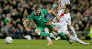 CAUGHT LATE: Ireland striker Jonathan Walters is tackled by Poland's Lukasz Szukata in last night's Euro 2016 qualifier at the Aviva Stadium.Picture: Donall Farmer