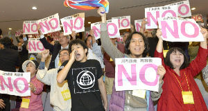 Anti-nuclear citizens shout their opposition.