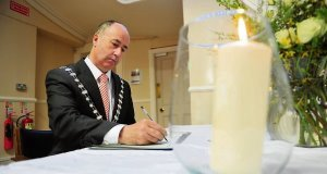 Cork County Mayor Alan Coleman signs the book of condolence for Karen Buckley in Mallow, Co Cork.