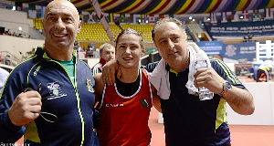 Katie Taylor celebrates after beating Yana Allekseevna in their 60kg Light Weight Final with coaches Pete Taylor, left, and Zaur Antia.