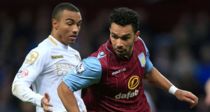 Aston Villa's Kieran Richardson and Bournemouth's Junior Stanislas (left) battle for the ball. Pic: PA