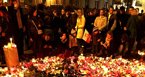 People place candles and lay flowers in front of the Presidential Palace in Warsaw, Poland.