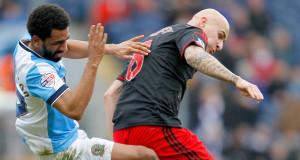 Blackburn's Lee Williamson  challenges Swansea City's Jonjo Shelvey. Picture: PA