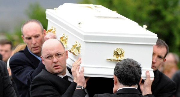 Tony Heffernan carries the remains of his son Liam to his final resting place. Picture: Don MacMonagle