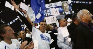 Likud supporters react with delight after Benjamin Netanyahu secured a decisive electoral victory last week, winning a third consecutive term in office. Netanyahu made a late surge after renouncing a commitment to a two-state solution with Palestine.
