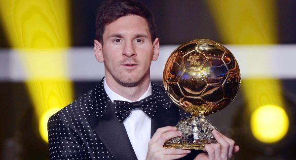 Lionel Messi poses with his Ballon d'Or trophy. Picture: AP