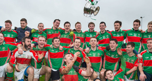 FLYING FORM: David Kennedy leads the Loughmore-Castleiney celebrations after their Tipperary SFC final replay win over Cahir at Leahy Park, Cashel.