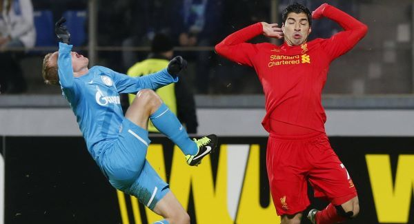 Liverpool's Luis Suarez, right, in action with Zenit's Aleksandr Anyukov tonight.