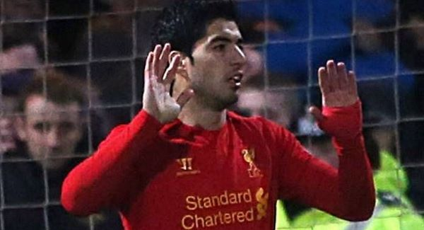 Hands up! Suarez celebrates his goal yesterday