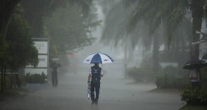 A Williams team crew member walks as the rain suspends the qualifying session today. Pic: PA
