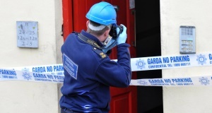 A member of the Garda forensics team at the scene of the fatal fire. Picture: Dan Linehan
