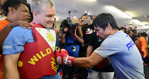 Manny Pacquiao spars with his coach Freddy Roach during a training session at the Wild Card Boxing Club in Hollywood, California ahead of his Las Vegas superfight against Floyd Mayweather. Picture: Frederic J Brown/AFP/Getty Images