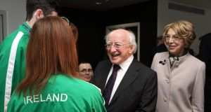 President Michael D Higgins and his wife Sabina meet Irish paralympic athlete Michael McKillop and rower Sarah Caffrey during a visit to the Olympic Stadium in Stratford, London today.