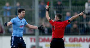 Michael Dara MacAuley of Dublin is sent off by referee David Gough. Pic: Inpho
