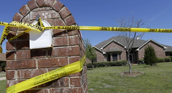 Crime scene tape is seen outside the home of Kaufman County District Attorney Mike McLelland and his wife. Picture: AP