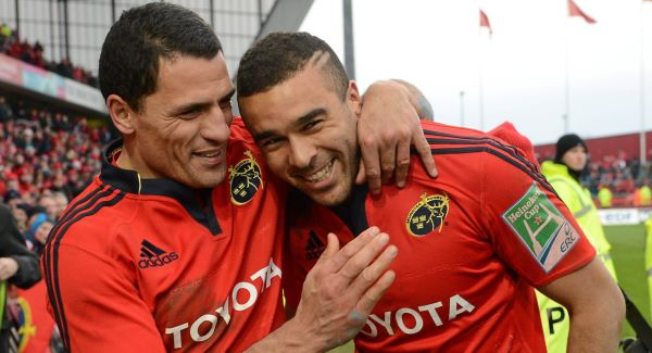 Munster's Simon Zebo is congratulated by captain Doug Howlett after the game.Picture: SPORTSFILE