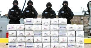 Members of the Irish navy standing behind the cocaine that was seized from Makayabella, 217 nautical miles off the south coast, in September of last year. It was valued at around €300m.Pictures: Michael Mac Sweeney/Cork Courts, Brian Lawless/PA Wire