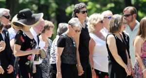 Family and friends arrive for a memorial service for Nancy Lanza yesterday.  (AP Photo/Jim Cole)
