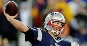 In this photo taken Sunday, Jan. 18, 2015, New England Patriots quarterback Tom Brady throws a pass during the first half of the AFC championship NFL football game against the Indianapolis Colts in Foxborough, Mass.