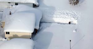 A man digs out his driveway in Depew, New York. Picture: AP