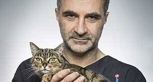 Noel Fitzpatrick with Pixie the cat;  the star of the Channel 4 TV show The Supervet, says he learned most about animal care from Dunmanway vet David Smith, with whom he worked for two years.