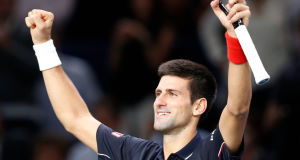 Novak Djokovic celebrates winning  (AP Photo/Michel Euler)