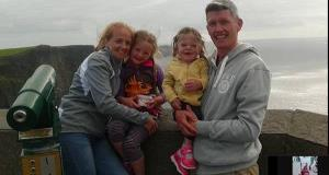Emma and John with their older two daughters