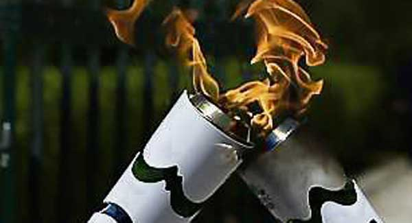 Protester attempts to put out Rio 2016 Olympic flame with fire extinguisher