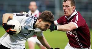 Omagh's Aaron Grugan with Slaughtneil's Patsy Bradley today. Picture: Inpho