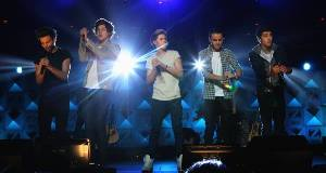 Boyband One Direction, above, won awards for artist of the year, favourite group (pop/rock), and favourite album (pop/rock.