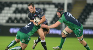 Ospreys' Dan Evans is tackled by Connacht's Jason Harris-Wright. Picture: INPHO/Ian Cook