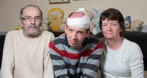 Paul Deaton with his parents Damien and Dorothy, as he was assaulted in a Dublin park on Wednesday. Picture: Fergal Phillips