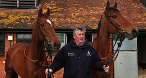 Paul Nicholls with his Gold Cup hopefuls Silviniaco Conti, left, and Sam Winner at his Ditcheat stables yesterday.