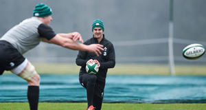 Ireland's Jonathan Sexton, centre, watches team-mate Paul O'Connell in action during squad training.
