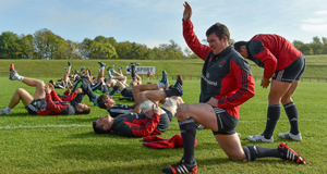 Captain Peter O'Mahony leads the team in stretching exercises  at University of Limerick  yesterday ahead of their European Rugby Champions Cup clash with Sale Sharks.