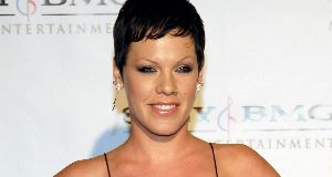 Pink is moving on fast after her split from husband Carey Hart - she has reportedly moved in with new beau Todd Morse.