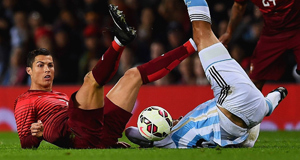 Portugal's Cristiano Ronaldo clashes with Argentina's Facundo Roncaglia during last night's friendly at Old Trafford.