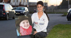 Roseann Brennan with a photo of her son Jake. She is  campaigning for a nationally imposed speed limit of 30km per hour.